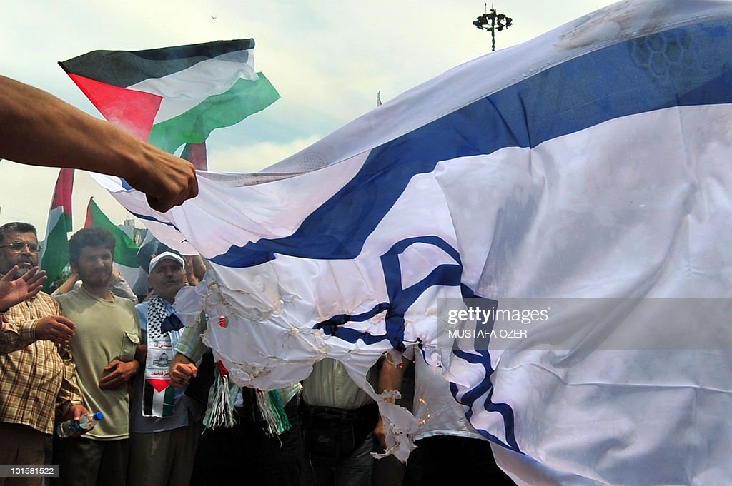 Turkish demonstrators burn a Israeli flag and shout slogans during an anti-Israeli protest on Taksim Square in Istanbul on May 31, 2010. The Israeli army said on May 31 that more than 10 passengers died and between 15 and 30 passengers were wounded when its forces stormed earlier in the day a flotilla of ships carrying aid to Gaza while a Turkish charity involved with the fleet put the death toll at at least 15 dead. Turkey condemned the attack, saying the Israeli operation may lead to 'irreparable consequences' in bilateral ties.