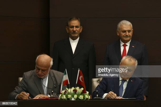 Turkish Deputy Minister of Environment and Urbanization Mehmet Ceylan and Iranian Deputy Foreign Minister Ibrahim Rahimpur sign a twoyear action plan...