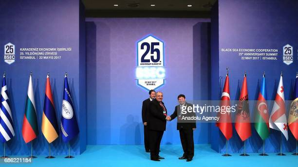 Turkish Deputy PM Tugrul Turkes shakes hands with Albanian Deputy Foreign Minister Halil Hyseni during the Organization of the Black Sea Economic...