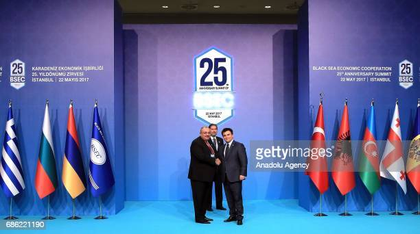 Turkish Deputy PM Tugrul Turkes shakes hands with Minister for Foreign Affairs of Ukraine Pavlo Klimkin during the Organization of the Black Sea...