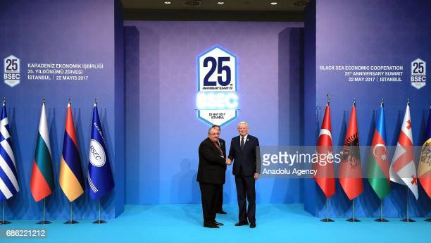 Turkish Deputy PM Tugrul Turkes shakes hands with Minister for Foreign Affairs of Romania Teodor Melescanu during the Organization of the Black Sea...