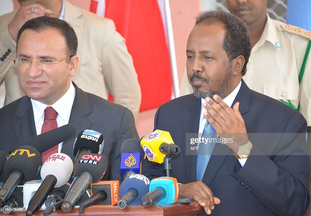 Turkish deputy prime minister Bekir Bozdag (L) and Somali president Hassan Sheikh Mohamud give a press conference after a meeting at presidential palace in Mogadishu, on February 23, 2013, as part of Bozdag's one-day official visit to Somalia. AFP PHOTO MOHAMED ABDIWAHAB
