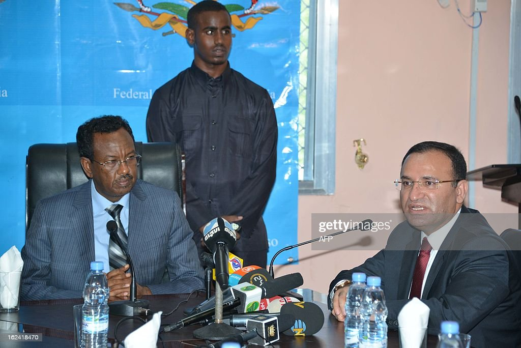 Turkish deputy prime minister Bekir Bozdag (L) and Somali Prime Minister Abdi Farah Shirdon (L) give a press conference after a meeting at presidential palace in Mogadishu, on February 23, 2013, as part of Bozdag's one-day official visit to Somalia.