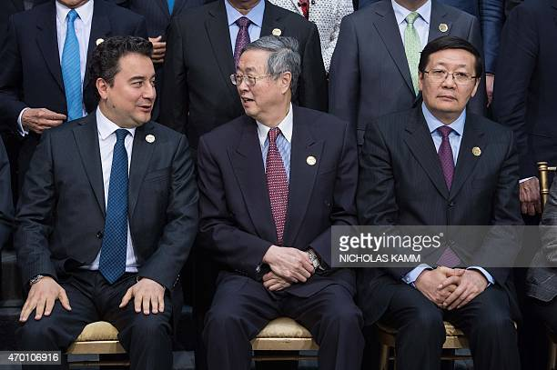 Turkish Deputy Prime Minister in charge of the economy Ali Babacan speaks with Chinese central bank governor Zhou Xiaochuan as Chinese Finance...