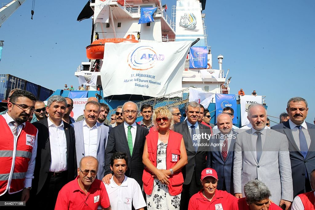 Turkish Deputy Prime Minister Veysi Kaynak (R-4) and Turkey's Minister of Development Lutfi Elvan (L-4) pose for a photograph as Turkish government sends Humanitarian aid to Gaza after Turkish-Israeli reconciliation deal, in Mersin, Turkey on July 1, 2016.