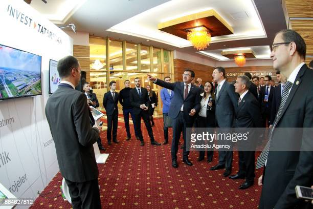 Turkish Economy Minister Nihat Zeybekci Russian Energy Minister Aleksander Novak and President of the Republic of Tatarstan Rustam Minnikhanov are...
