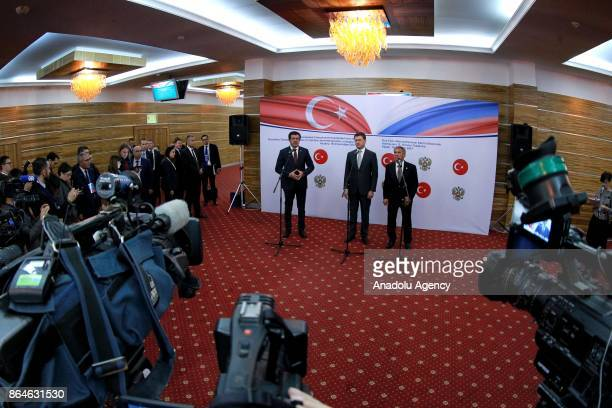 Turkish Economy Minister Nihat Zeybekci Russian Energy Minister Aleksander Novak and President of the Republic of Tatarstan Rustam Minnikhanov hold a...