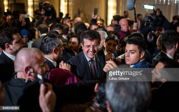 Turkish Economy Minister Nihat Zeybekci talks to Turkish people after an event organized by the Turkish AKP the political party of Turkish President...