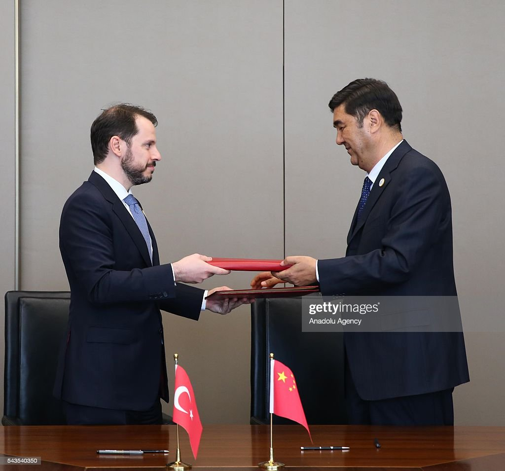 Turkish Energy and Natural Resources Minister Berat Albayrak (L) and China's Director of the National Energy Administration, Nur Bekri are seen after signing a cooperation agreement regarding the nuclear energy during the G20 Energy Ministrial meeting in Beijing, China on June 29, 2016.