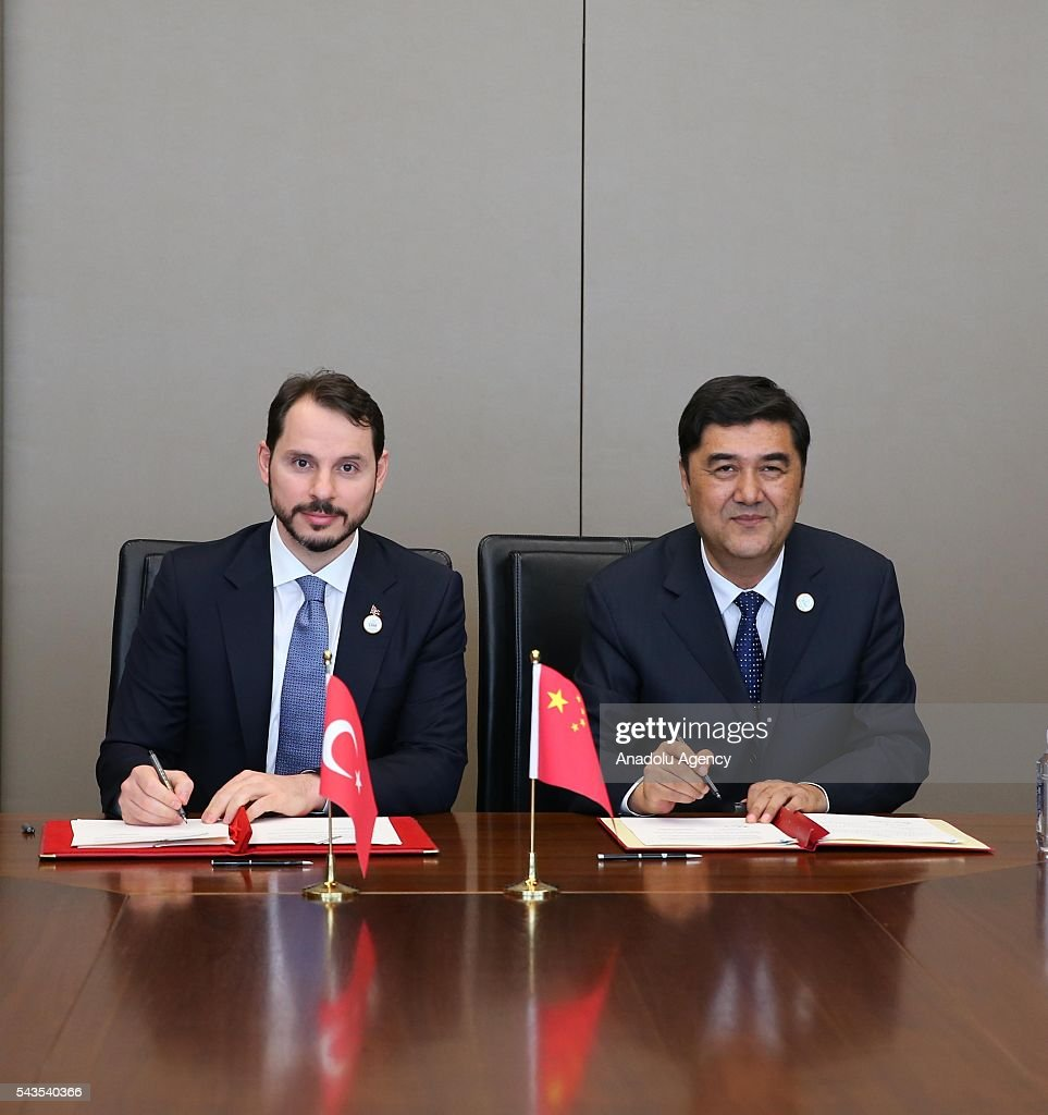 Turkish Energy and Natural Resources Minister Berat Albayrak (L) and China's Director of the National Energy Administration, Nur Bekri sign a cooperation agreement regarding the nuclear energy during the G20 Energy Ministrial meeting in Beijing, China on June 29, 2016.
