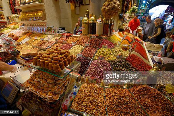 Turkish family shopping for dryed fruit in the Egyptian Spice Bazaar Istanbul