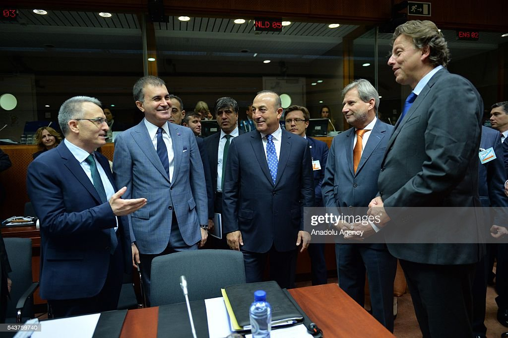 Turkish Finance Minister Naci Agbal (L), Turkey's EU Minister Omer Celik (L 2), Turkish Foreign Minister Mevlut Cavusoglu (C), Commissioner for European Neighbourhood Policy & Enlargement Negotiations, Johannes Hahn (R2) and Foreign Affairs Minister of Holland Bert Koenders (R) attend the Chapter 33 on financial and budgetary provisions as part of the EU-Turkey Intergovernmental Accession Conference in Brussels, Belgium on June 30, 2016.