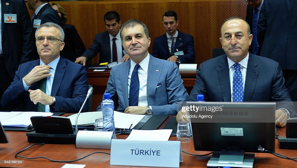 Turkish Finance Minister Naci Agbal (L),Turkey's EU Minister Omer Celik (C) and Turkish Foreign Minister Mevlut Cavusoglu (R) attend the Chapter 33 on financial and budgetary provisions as part of the EU-Turkey Intergovernmental Accession Conference in Brussels, Belgium on June 30, 2016.