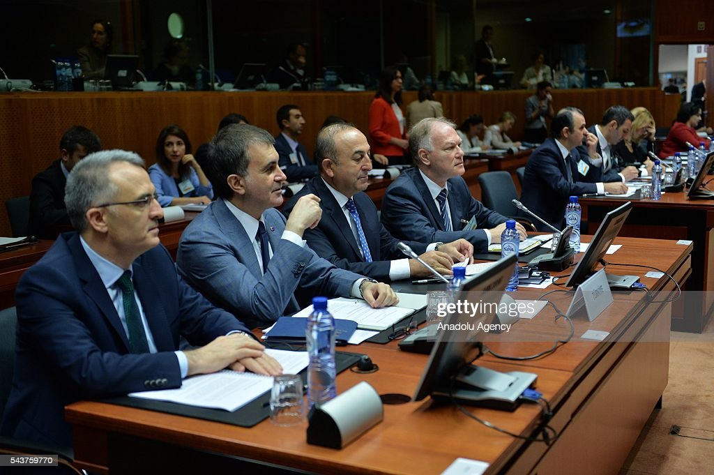 Turkish Finance Minister Naci Agbal (L),Turkey's EU Minister Omer Celik (C) and Turkish Foreign Minister Mevlut Cavusoglu (R2) attend the Chapter 33 on financial and budgetary provisions as part of the EU-Turkey Intergovernmental Accession Conference in Brussels, Belgium on June 30, 2016.
