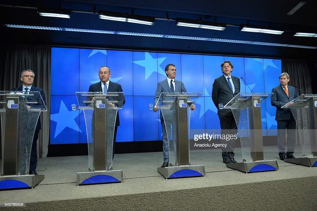 Turkish Finance Minister Naci Agbal (L), Turkish Foreign Minister Mevlut Cavusoglu (L2) Turkey's EU Minister Omer Celik (C), Foreign Affairs Minister of Holland Bert Koenders (R2) and the Commissioner for European Neighbourhood Policy & Enlargement Negotiations, Johannes Hahn (R) speak during a joint press conference after the Chapter 33 on financial and budgetary provisions as part of the EU-Turkey Intergovernmental Accession Conference in Brussels, Belgium on June 30, 2016.