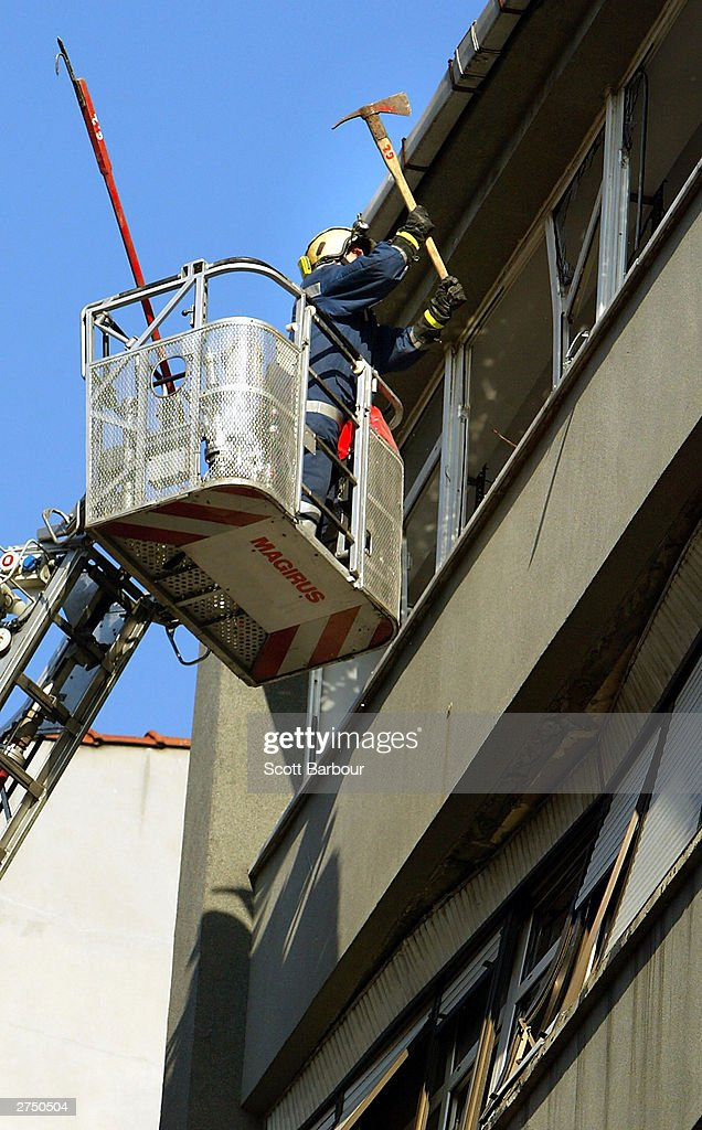 A Turkish firefighter clears the glass from broken windows near the scene of the British Consulate bombing November 21, 2003 in Istanbul, Turkey. Bomb attacks on the British consulate and the HSBC bank headquarters on November 20, 2003 killed at least 27 people and left hundreds injured.