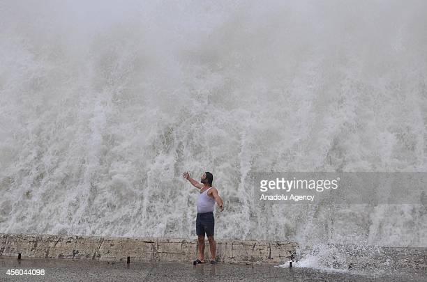 Turkish fisherman enjoys the huge waves which begin to strike the seafront of Inebolu a coastal city of Kastamonu in northern Turkey on September 24...