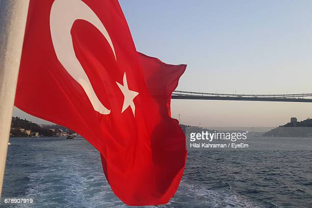 Turkish Flag Against River On Sunny Day