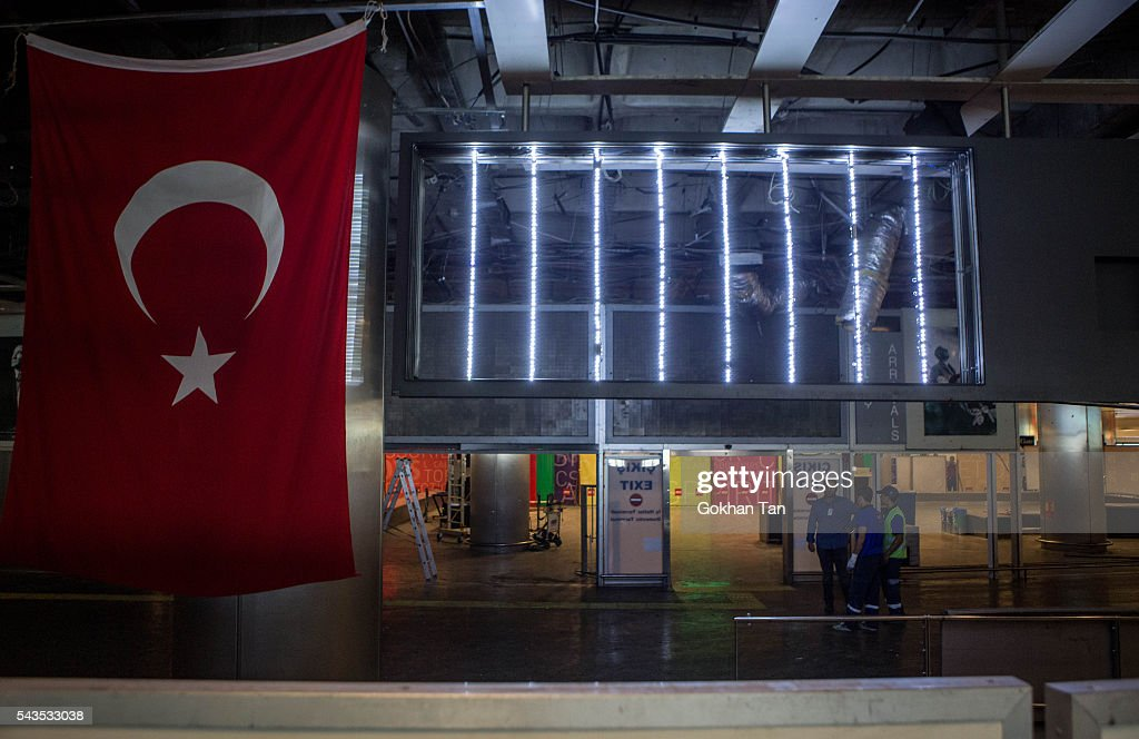 A Turkish flag hangs in the blast site at Turkey's largest airport Istanbul Ataturk on June 29, 2016 in Istanbul, Turkey. Three suicide bombers opened fire before blowing themselves up at the entrance to the main international airport in Istanbul yesterday. The Istanbul Governor's Office says 41 people have been killed, 37 of the victims have been identified, including 10 foreign nationals and three people with dual citizenship. More than 230 people were wounded but 109 have been discharged from hospitals in the deadly suicide bombing attack in Istanbul's Ataturk airport blamed on the Islamic State group.