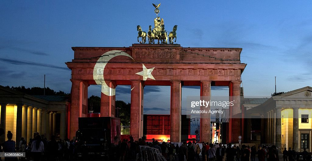 Turkish flag is projected on historical Brandenburg Gate as people gather at Pariser Platz following the recent terror attack at Istanbul Ataturk Airport, on June 29, 2016 in Berlin, Germany.