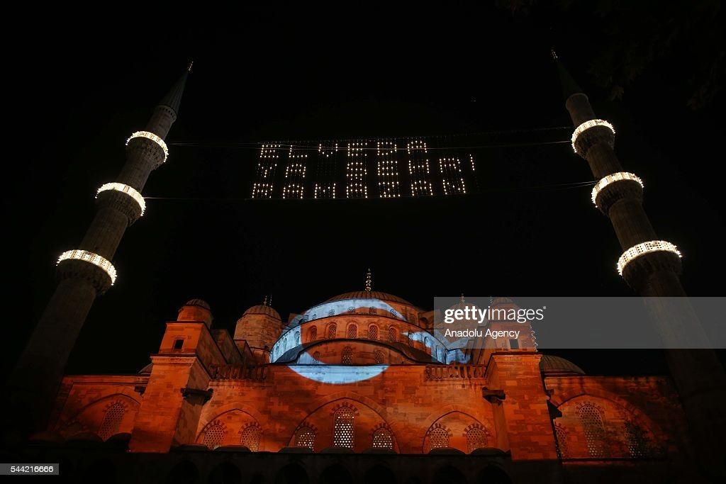Turkish flag is projected on Sultanahmet Mosque as muslims perform prayer on the Laylat al-Qadr, the night when the first verses of the Quran were revealed, in Istanbul, Turkey on July 1, 2016.