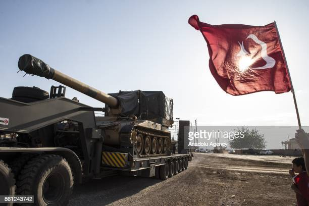 Turkish flag undulates as Turkish Army's armoured vehicles are deployed to the Reyhanli border due to the transition to Idlib deconflict zone in...