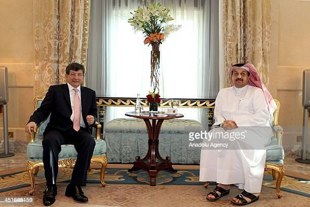 Turkish FM Ahmet Davutoglu meets with his Qatari counterpart Khalid Bin Muhammed Al Atiyye in Doha Qatar on November 24 2013