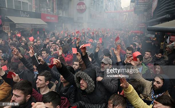 Turkish football club Trabzonspor fans hold red cards as they protest against referee Deniz Ates Bitnel who has showed 4 red cards to Trabzonspor...