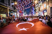 TOPSHOT Turkish football supporters take part in a rally against the military coup on Taksim square in Istanbul on July 23 2016 Turkey pushed on with...