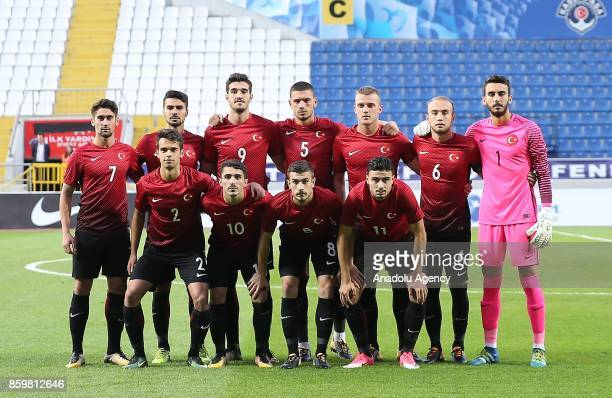 Turkish footballers pose for a photo before ahead of the 2017 UEFA European Under21 Championship qualification Group 6 football match Turkey and...