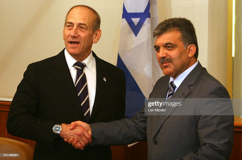 Turkish Foreign Minister Abdullah Gul (R) shakes hands with Israeli Prime Minister <a gi-track='captionPersonalityLinkClicked' href=/galleries/search?phrase=Ehud+Olmert&family=editorial&specificpeople=178946 ng-click='$event.stopPropagation()'>Ehud Olmert</a> after their meeting in Jerusalem on Sunday Aug. 20 2006.