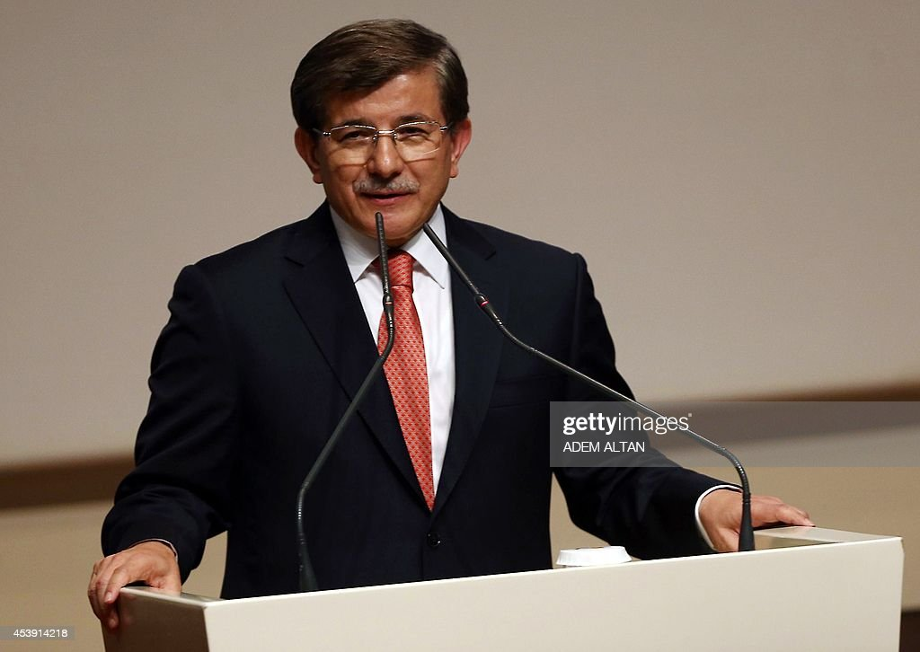 Turkish Foreign Minister <a gi-track='captionPersonalityLinkClicked' href=/galleries/search?phrase=Ahmet+Davutoglu&family=editorial&specificpeople=4940018 ng-click='$event.stopPropagation()'>Ahmet Davutoglu</a> addresses a meeting of the Justice and Development Party (AKP) in Ankara on August 21, 2014. Turkish president-elect Recep Tayyip Erdogan named Davutoglu to succeed him as ruling party leader and prime minister, promoting an ally who is expected to show unstinting loyalty to the new head of state. AFP PHOTO/ADEM ALTAN