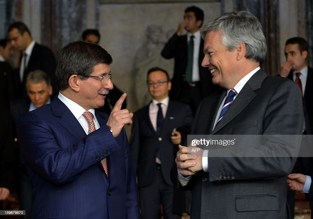 Turkish Foreign Minister Ahmet Davutoglu (L) and Belgian Vice-Prime Minister and Foreign Minister Didier Reynders speak during a meeting of Turkish and Belgian officials to discuss subjects of joint interest during a meeting of Turkish and Belgian officials to discuss subjects of joint interest on January 22, 2013 at the Egmont Palace (Egmontpaleis - Palais d'Egmont) in Brussels.