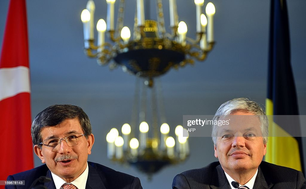 Turkish Foreign Minister Ahmet Davutoglu (L) and Belgium Vice-Prime Minister and Foreign Minister Didier Reynders sit during a bilateral meeting on January 22, 2013 at the Egmont Palace in Brussels.