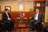 Turkish Foreign Minister Ahmet Davutoglu and Iraqi Foreign Minister Hoshyar Zebari meet in Sulaymaniyah Iraq on March 4 2014