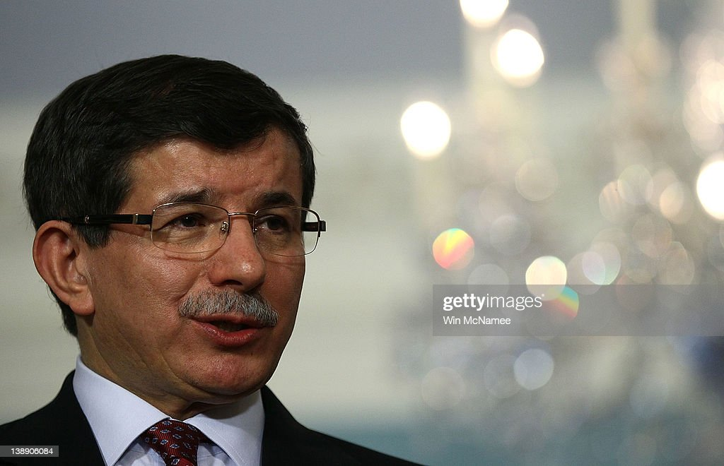 Turkish Foreign Minister <a gi-track='captionPersonalityLinkClicked' href=/galleries/search?phrase=Ahmet+Davutoglu&family=editorial&specificpeople=4940018 ng-click='$event.stopPropagation()'>Ahmet Davutoglu</a> answers a question during a press conference with U.S. Secretary of State HIllary Clinton at the U.S. State Department February 13, 2012 in Washington, DC. Clinton and Davutoglu have been meeting in Washington on regional issues including Syria and Iran over the past several days.