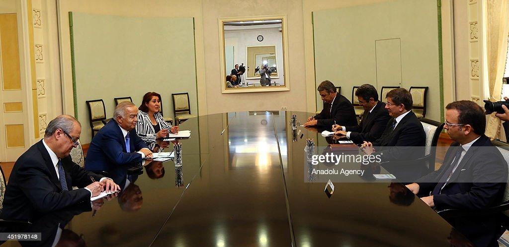 Turkish Foreign Minister Ahmet Davutoglu (2nd R) meets with Uzbekistan President Islam Karimov (2nd L) in Tashkent, Uzbekistan on 10 July, 2014.