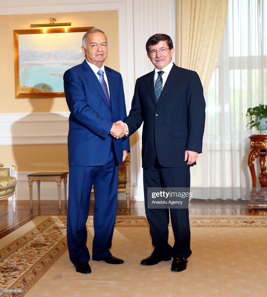 Turkish Foreign Minister Ahmet Davutoglu (R) meets with Uzbekistan President Islam Karimov (L) in Tashkent, Uzbekistan on 10 July, 2014.