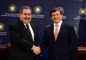 Turkish Foreign Minister Ahmet Davutoglu shakes hand with Iraqi Foreign Affairs Minister Hoshyar Zebari after a press conference in Ankara Turkey