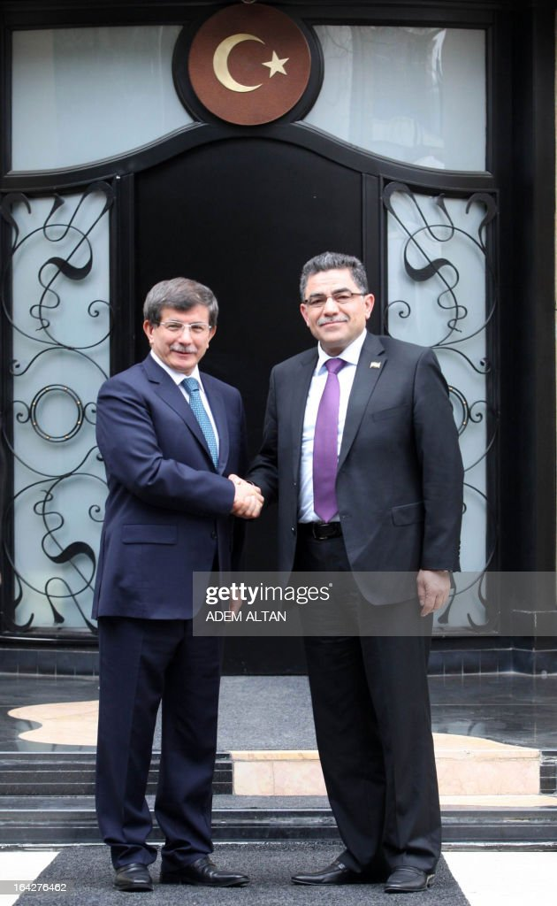 Turkish Foreign minister Ahmet Davutoglu (R) shakes hands with Syrian opposition prime minister Ghassan Hitto prior to a meeting in Ankara, on March 22, 2013. In a new challenge to the regime of Syrian President Bashar al-Assad, the Syria's main opposition National Coalition appointed Hitto after some 14 hours of closed-door consultations in the Turkish city of Istanbul on March 19, 2013.