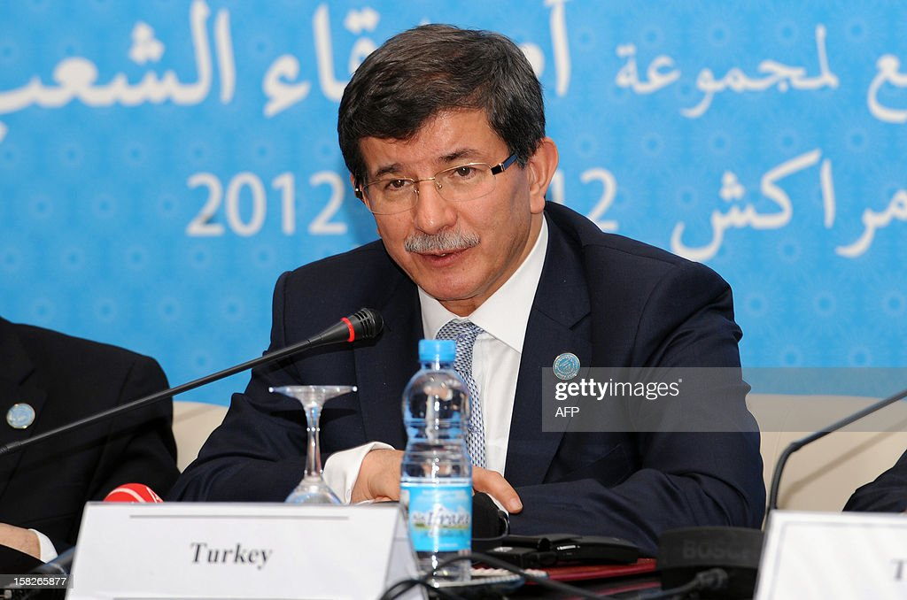 Turkish Foreign Minister Ahmet Davutoglu speaks at the Friends of Syria conference in Marrakesh on December 12, 2012. The talks on the 21-month conflict rocking Syria brought together representatives from 114 countries, including about 60 ministers, the Syrian opposition and international organisations. AFP PHOTO/FADEL SENNA