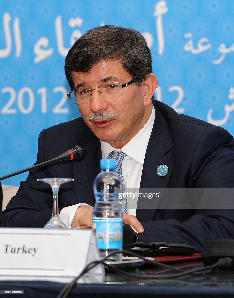 Turkish Foreign Minister Ahmet Davutoglu speaks at the Friends of Syria conference in Marrakesh on December 12, 2012. The talks on the 21-month conflict rocking Syria brought together representatives from 114 countries, including about 60 ministers, the Syrian opposition and international organisations.