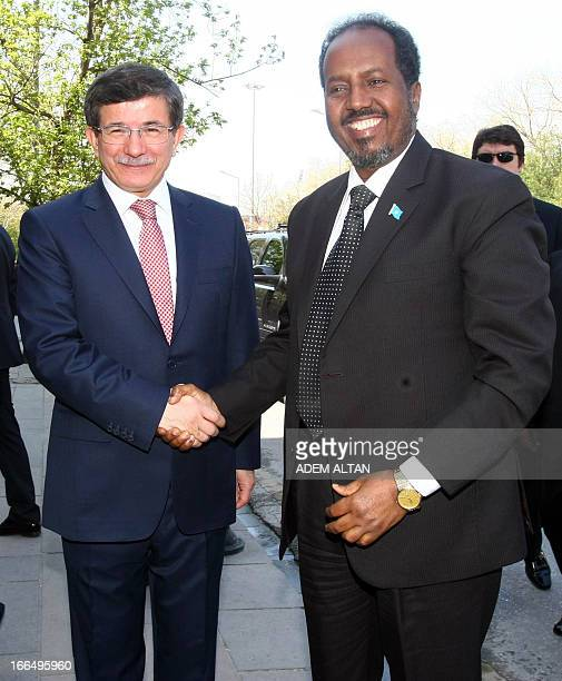 Turkish Foreign Minister Ahmet Davutoglu welcomes Somalia's President Hassan Sheikh Mohamud as he arrives for a meeting with Somaliland's President...