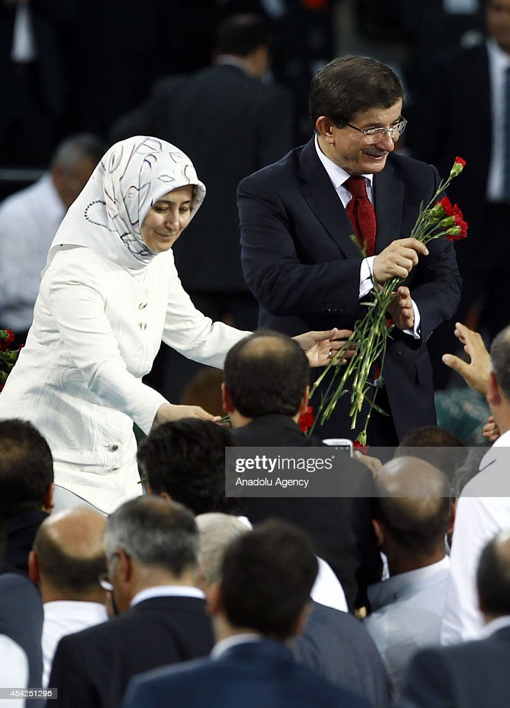 Turkish Foreign Minister and new chairman of the Justice and Development Party (AK Party) Ahmet Davutoglu and his wife Sare Davutoglu greet the supporters of AK Party during 2014 AK Party Extraordinary Congress at Ankara Arena Stadium in Ankara, Turkey on August 27, 2014. Turkish ruling Justice and Development Party delegates have chosen Foreign Minister Ahmet Davutoglu as party's new chairman.