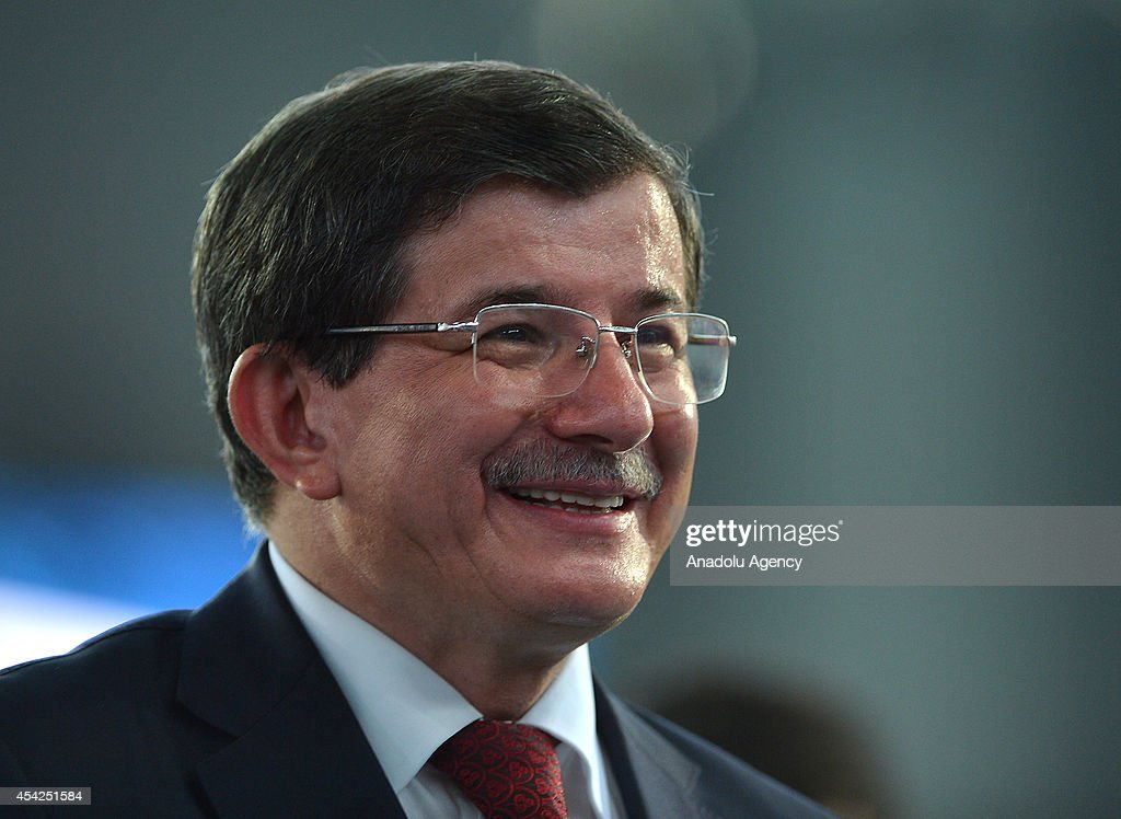 Turkish Foreign Minister and new chairman of the Justice and Development Party (AK Party) Ahmet Davutoglu greets the supporters of AK Party during 2014 AK Party Extraordinary Congress at Ankara Arena Stadium in Ankara, Turkey on August 27, 2014. Turkish ruling Justice and Development Party delegates have chosen Foreign Minister Ahmet Davutoglu as party's new chairman.
