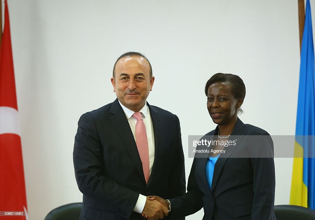 Turkish Foreign Minister Cavusoglu (L) and Minister of Foreign Affairs and Cooperation of Rwanda Louise Mushikiwabo (R) shake hands during a press conference in Kigali, Rwanda on May 31, 2016.