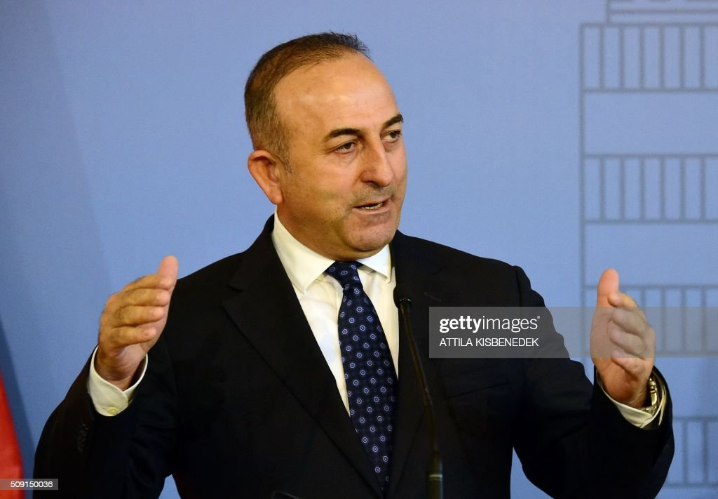 Turkish Foreign Minister Mevlut Cavusoglu addresses a joint press conference with Hungary's Minister of External Economy and Foreign Affairs, Peter Szijjarto (unseen) at the Conference Hall of the ministry building in Budapest, on February 9, 2016. / AFP / ATTILA KISBENEDEK