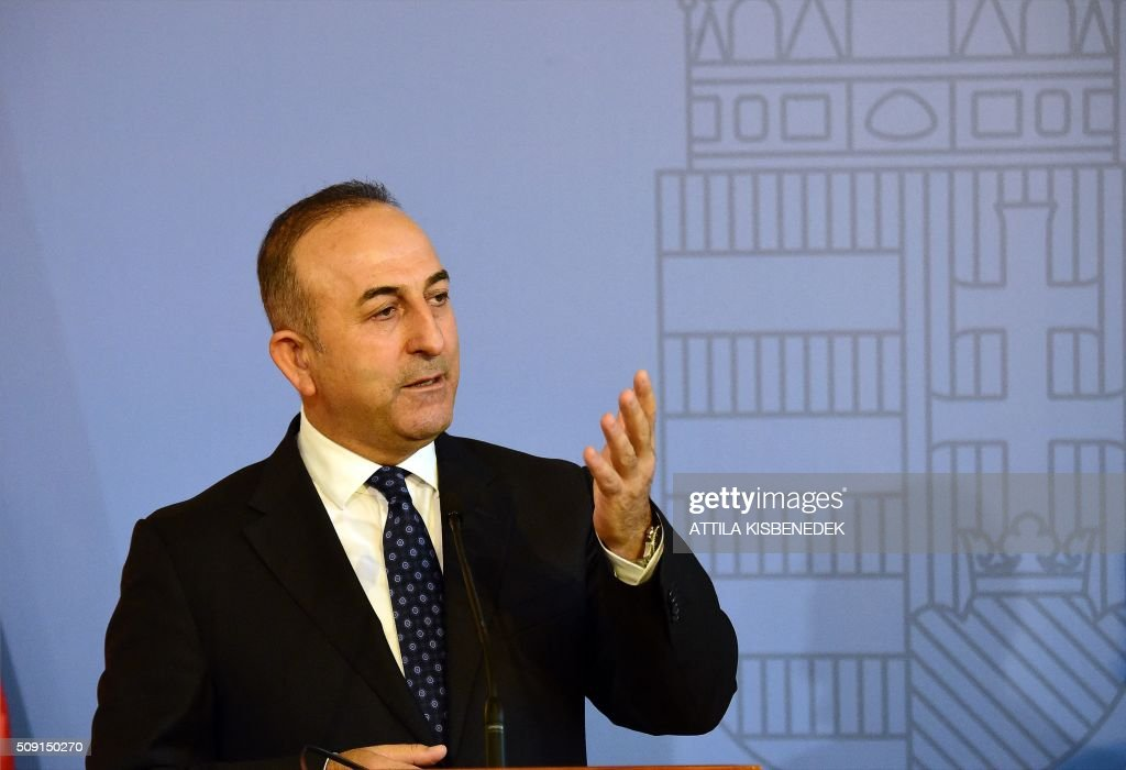 Turkish Foreign Minister Mevlut Cavusoglu addresses a joint press conference with Hungary's Minister of External Economy and Foreign Affairs, Peter Szijjarto (unseen), at the Conference Hall of the ministry building in Budapest, on February 9, 2016. / AFP / ATTILA KISBENEDEK