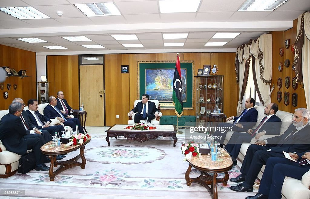 Turkish Foreign Minister Mevlut Cavusoglu (3rd L) and Chairman of the Presidential Council of Libya Fayez al-Sarraj (R) are seen during their meeting in Tripoli, Libya on May 30, 2016.