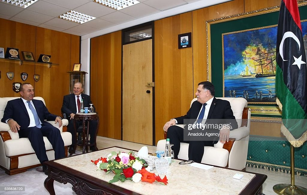 Turkish Foreign Minister Mevlut Cavusoglu (L) and Chairman of the Presidential Council of Libya Fayez al-Sarraj (R) are seen during their meeting in Tripoli, Libya on May 30, 2016.